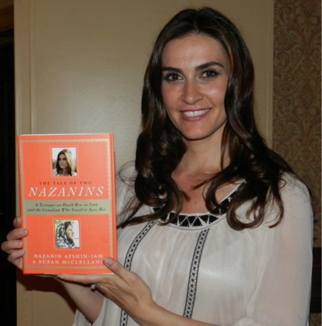 Nazanin Afshin-Jam holds up a copy of her book, The Tale Of Two Nazanins, which explores the true story of how she vowed to save the life of a teenager also named Nazanin who was on death row in Iran. Her book reading was at the Charlottetown Hotel on July 27. Ancelene MacKinnon photo