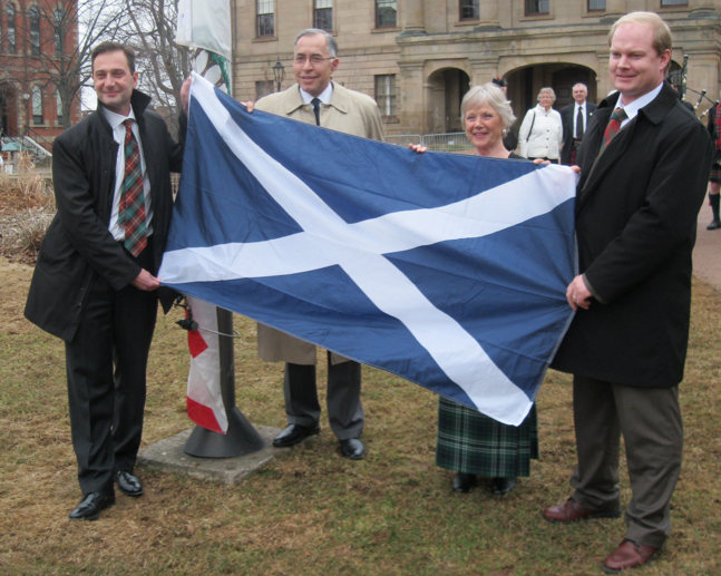 From left to right: Premier Robert Ghiz, Horatio Toledo, Eleanor Boswell, president of the Caledonian Club, and Belfast-Murray River MLA Charles McGeoghegan, hold the Scottish flag as it was about to be flown at the Legislative Assembly on April 10. Jillian Trainor photo.