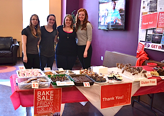Zoe Arsenault, Emile Boucher, Tiffany McMillian and Amy Wells, students in the fundamental arts and graphic design program hold a bake sale to raise money at Holland College on Jan. 17 for the NYC Creative Minds Event.  Laura Hines photo.