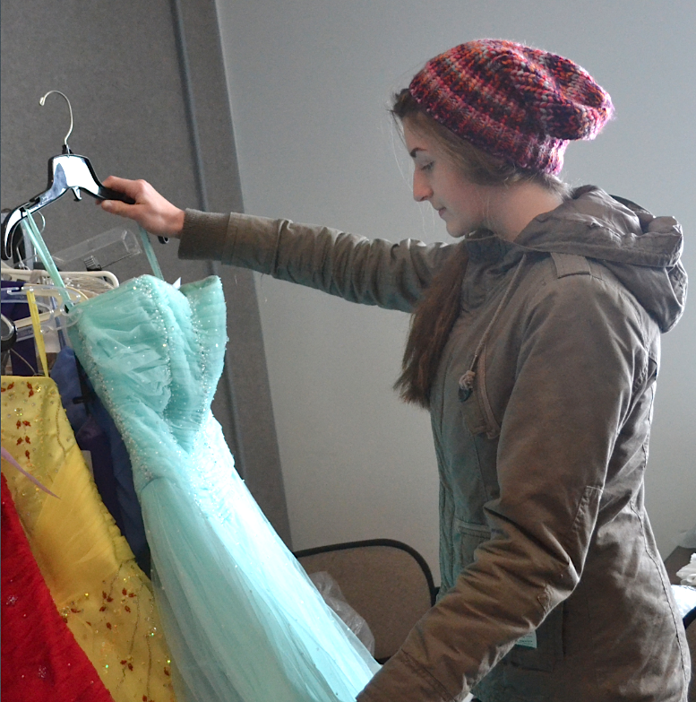 Kassandra Moriarty hunts for the perfect prom dress at the Stratford Prom Dress Consignment Sale Jan. 25 at the Stratford town hall. Sarah Seeley photo.