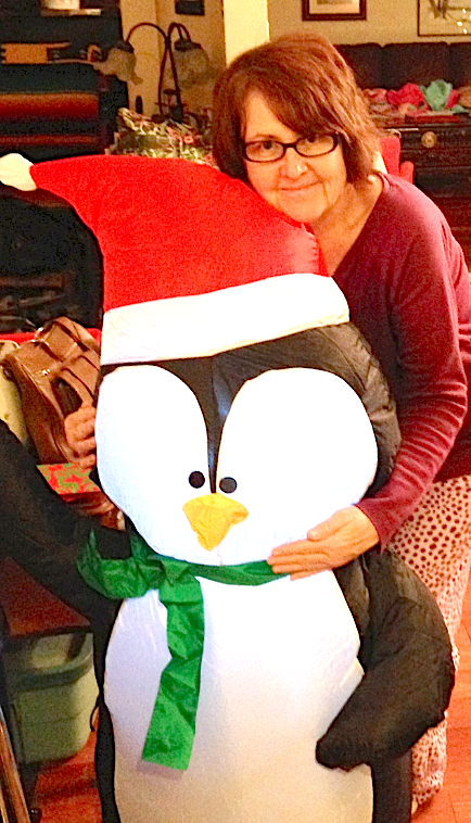 Theresa Gallagher hugs an inflatable penguin in her P.E.I. home over a recent January weekend.  Rosie Townshend-Carter photo.
