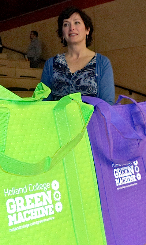 Joan Diamond, a member of the Holland College Green Machine, stands with reusable shopping bags given as prizes at an energy conservation presentation given at Holland College Feb. 5. Gwydion Morris photo