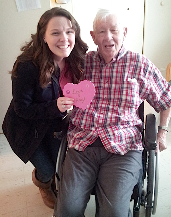 Alyssa Fraser gives Don Harris a Valentine card at Garden Home in Charlottetown on Feb. 14. It was part of a community service activity for her course at UPEI. Kayla Fraser photo.