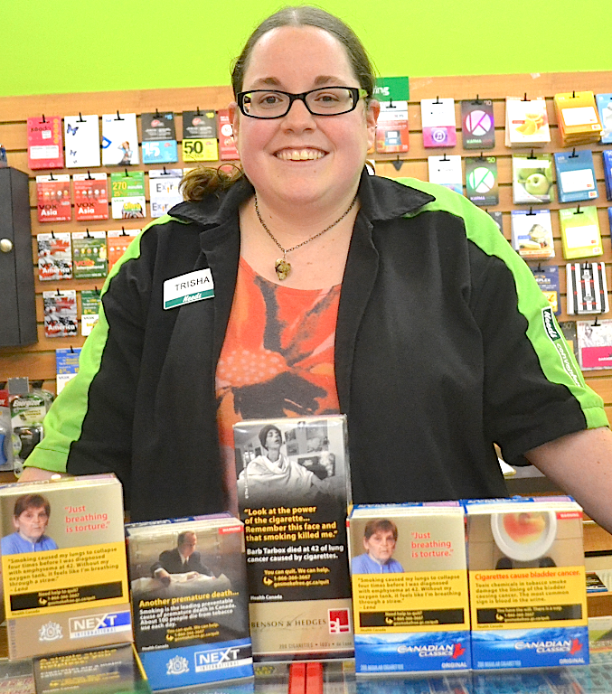 Stratford Needs manager Trisha Hartling displays the store's selection of cigarettes. Sarah Seeley photos.