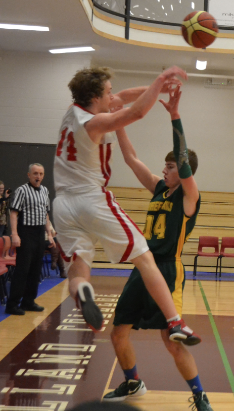 One of Charlottetown Rural's top scorers, Noah Giddings, gets the ball over to a teammate resulting in a basket. Rural beat Three Oaks 89-38. Laura Hines photo.