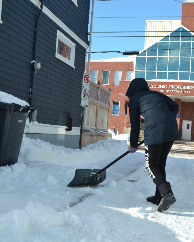 Melissa Gallant shovels snow off her walkway and driveway after a recent storm. Jazlyn MacLeod photo.