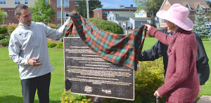 P.E.I. Premier Robert Ghiz and Nancy Baron help to unveil a new plaque Sept. 12 at Joe Ghiz Park in Charlottetown to commemorate the completion of the province's portion of the Trans Canada Trail. Ally Harris photo.