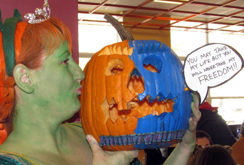 Angela Dowie, a Holland College photography student, kisses her award-winning, Braveheart-themed Most Original pumpkin during the pumpkin-carving contest held at the college on Oct. 30. Melissa Heald photo.