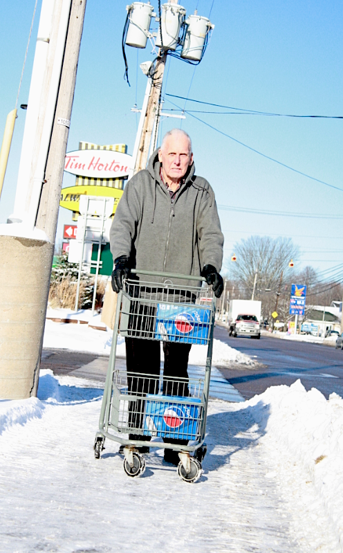 John Kelly is about to cross St. Peters Road and is concerned with pedestrian safety.  Jerry Laird photo.