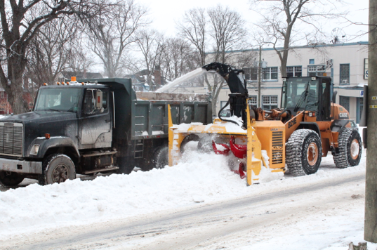 Workers with the city of Charlottetown clean a strip of snow remaining in the middle of the road on Hillsborough Street, two days after a snowstorm on Jan. 30. Drake Lowthers photo.