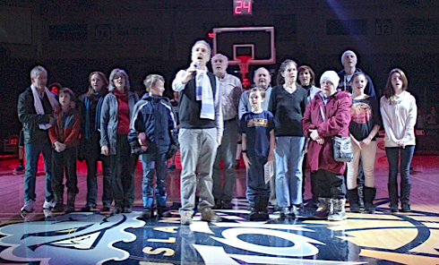 John Bennett, centre, of Harvest House sings Oh Canada with members of Charlottetown's Coldest Night Of The Year at the Island Storm basketball game at the Eastlink Centre Feb. 26. Drake Lowthers photo.