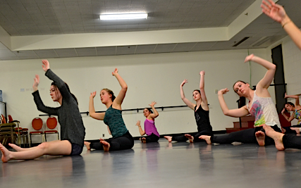Dancers practice stretches with Taryn Vankerk at the Open Studio Day in the Confederation Centre on March 6, 2015. Eileen Jones photo.
