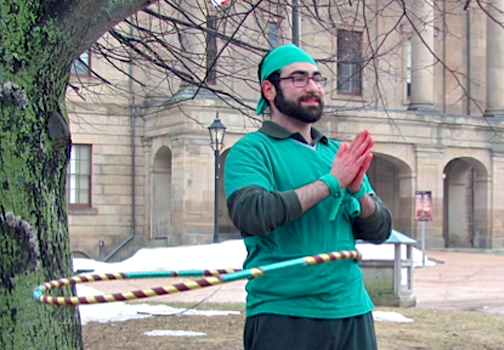 Ali Eftekhar hula-hoops in front of Province House in Charlottetown to raise awareness for the Green Party of P.E.I. Maggie Muttart photo.