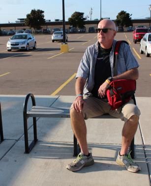 Charlottetown resident Matthew Mackay waits for the bus at the Charlottetown mall bus stop Sept. 16. Rebecca Moase photo.