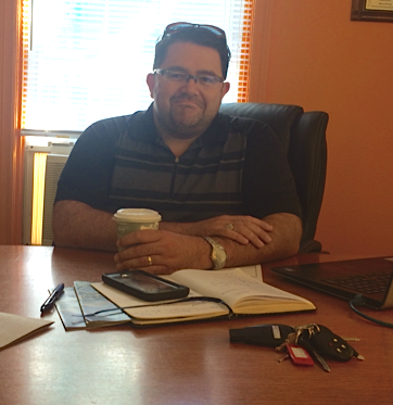 Jason Pitre from P.E.I apartments sits in his office in downtown Charlottetown and discusses the cost of housing prices and lack of vacancy. Emily Walsh photo.