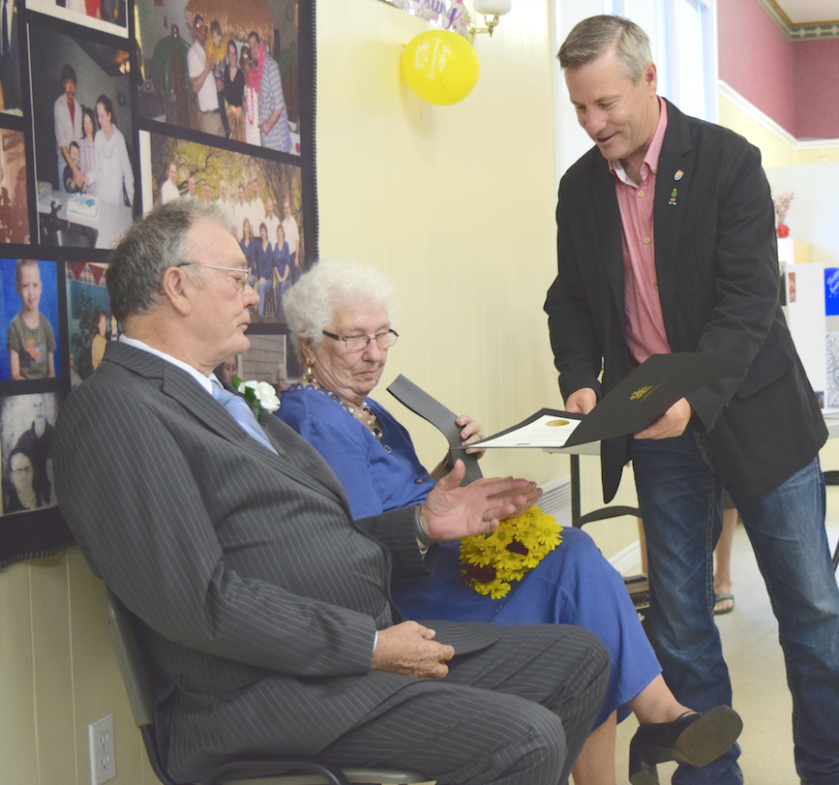 Leaman and Jennie MacLeod receive a certificate for celebrating their 60th wedding anniversary. It was presented by MLA Robert Henderson on behalf of Premier Wade MacLauchlan on Sept. 20 at the old school house in Northam. Sydney Clay photo.