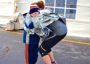 Thomas Francis, 6, hugs his mother Brandy after she completed P.E.I. half marathon in 1:59:26 Oct. 18 in downtown Charlottetown. Millicent McKay photo