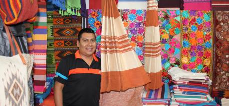 Francisco Ruiz selling fabrics at the local market in Manzanillo, Mexico on Jan.27, 2016. Tori Vail photo.